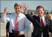 Democratic presidential candidate Sen. John Kerry, D-Mass., left, and Sen. John Edwards, D-N.C., arrive at Miami International Airport in this April file photo. Kerry selected Edwards to be his running mate.