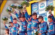 New overall leader Lance Armstrong, fifth from right, and his U.S. Postal Service teammates celebrate their team time-trial victory. The victory in Wednesday's fourth stage of the Tour de France gave Armstrong the overall lead for the first time this Tour.