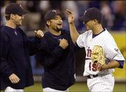 Minnesota's Kyle Lohse, right, is congratulated by Johan Santana, center, and Brad Radke after a 12-0 win over Kansas City. Each of the three pitchers shut out the Royals in the series. Lohse won Wednesday in Minneapolis.
