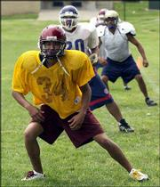 Micah Swimmer of Cherokee NC, Cherokee High School, participates in drills with the members of the east squad of the Native American All-Star Football Game at Haskell Indian Nations University. The game will be 7:30 pm Saturday at Haskell Stadium.