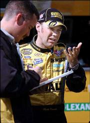 NASCAR Nextel Cup driver Matt Kenseth, right, talks with a member of his crew. Kenseth, shown March 27 in Bristol, Tenn., is hoping to make a charge at Sunday's Tropicana 400.