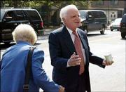 Shirlee Leete, left, a personal assistant, helps John Rigas, founder and former CEO of cable television giant Adelphia Communications. They prepared to enter federal court on Thursday in New York. Rigas was found guilty Thursday on fraud and conspiracy charges.