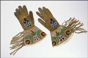 The Gloves were made of buckskin, fiber and glass beads by a member of the Potawatomi tribe.