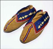 "These moccasins, made from leather, glass beads and ribbon applique, were created by a member of the Delaware Indian tribe. They're part of ""Vanished Voices: The Legacy of Northeast Kansas Indians,"" which opens Saturday in the Spencer Museum of Art's White Gallery."