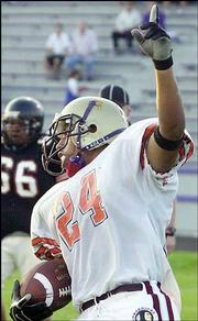 Bracey Billie of the East celebrates a touchdown against the West. The East won, 34-7, Saturday at Haskell Stadium.