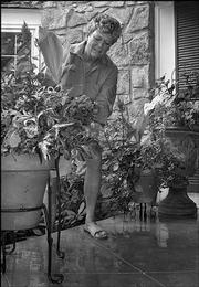 "This photo of Mary Olson, Lawrence, although similar to the portrait of her <a href= ""http://ljworld.com/section/gardening/story/175431"">in this gardening story</a>, was taken with a semi-wide-angle lens. A medium wide-angle lens is one of the most versatile of lenses for a photographer. A 120mm telephoto lens was used for the photo of Olson in the other story."