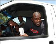 Lakers center Shaquille O'Neal, right, chats with reporters about a possible trade. O'Neal spoke briefly Saturday after leaving a real estate office in Orlando, Fla.