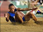 Marion Jones lands after her first jump in the women's long-jump qualifying round at the U.S. Olympic track and field trials. Jones on Monday advanced to Thursday's finals in the event in Sacramento, Calif.