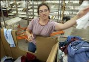 Blanca Batlen, Lawrence, sorts clothing at Helping Hands of Goodwill Industries, 2200 W. 31st St. Officials with the Kansas City, Mo.-based company plan to relocate the store to avoid the high property taxes at its current location.