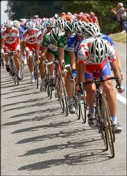 The pack rides through the countryside during the ninth stage of the Tour de France. Robbie McEwen won the stage Tuesday between Saint-Leonard-de-Noblat and Gueret, France, but Thomas Voeckler retained the overall lead of the race.