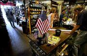 Customers shop at Chagrin Hardware in Chagrin Falls, Ohio, in this July 3 photo. America's shoppers had a tight grip on their pocketbooks and wallets in June, dropping sales at retailers by 1.1 percent. It was the largest decline in 16 months.