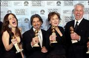 "The cast of ""Angels in America,"" from left, Mary Louise Parker, Al Pacino and Meryl Streep, hold their awards at the 61st Annual Golden Globes in Beverly Hills, Calif., in this Jan. 25, 2004, file photo. The HBO miniseries received a leading 21 Emmy nominations Thursday from the Academy of Television Arts and Sciences in Los Angeles."