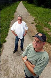 Rails-to-trails advocates Jim McCray, left, and Clark Coan envision a trail for biking and walking that would span from the Wakarusa River to the Kansas River. Both are pictured on Monday near 23rd Street and Learnard Avenue, where the Haskell Trail ends.