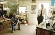 Bob Goodrow, Hays, left, sits in the Sport Haven Bait and Tackle shop near the Cedar Bluff Reservoir while Rep. Jerry Moran talks with the store's manager, Jeff Woodworth. Moran stopped at the shop for bottled water.