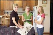 Robba Moran, wife of Congressman Jerry Moran, visits with their daughters, Kelsey, 16, left, and Alex, 13, at their home in Hays. Robba is a graduate of Duke University's law school and gave up practicing and teaching law for motherhood and homemaking. She is involved in many activities in Hays and is chairwoman of the Kansas State Fair Board.