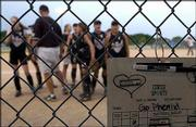 The roster for the Phenix Rusk 14-under softball squad still contains the name of Krystal Bateson, a Phenix player who died on a softball trip earlier this summer. The Phenix Rusk lost to the K.C. Wild Things, 4-3, Thursday at Clinton Lake Softball Complex.
