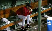 Boston starting pitcher Curt Schilling sits in the dugout after an 8-7 loss to New York. Schilling gave up seven runs on seven hits Friday night at Fenway Park in Boston.