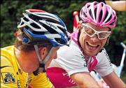 Jan Ullrich of germany, right, jokes with overall leader Lance Armstrong during the 18th stage of the Tour de France. The pair rode Friday between Annemasse and Lons-le-Saunier, France. Juan Miguel Mercado of Spain won the stage.