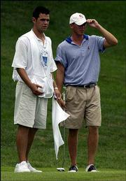 Kansas University golfer Kevin Ward, right, attempts to read a green with KU teammate Gary Woodland at the Kansas Amateur Match Play Championship. Woodland caddied for Ward on Friday in Olathe.