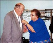 Master Mason Robert Etherton, a member of Lawrence Masonic Lodge No. 6, receives his 50-year medal from his wife, Jean. The award was pinned on him during ceremonies June 4 at the Holcom Recreation Center, 2700 W. 27th St.
