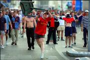 An English soccer fan throws a restaurant chair toward riot police after clashes erupted between English and Tunisian soccer fans June 14, 1998. The British government hopes to cut down on the illness, accidents, violence, lost productivity and crime associated with drinking.