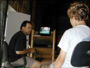 Wilson Kilmer, one of the coaches of the University Bank 88s baseball team and the owner of Home Plate Baseball, gives 88s player Cody Jones some pointers while watching a video of Jones hitting July 1 at Home Plate's headquarters. The 88s finished first in the Shawnee County Amateur Baseball Ass. Gopher League on the strength of their win against the River Bandits, July 19.