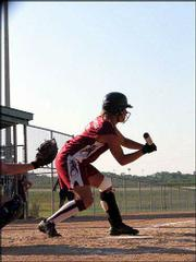 "16-U Phenix T&squot;s player Jessica Simecka prepares to lay down a bunt against the Flames of Nebraska in an American Fastpitch Assn. National ""B"" Tournament pool play game July 20. The Phenix T&squot;s lost the game 4-2."