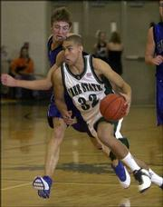 Free State guard Dain DIllingham, right, drives past Washburn Rural's Jordan Plachecki in this Dec. 5, 2003 file photo. Dillingham will focus on basketball at Drake University, opting not to play football for the Bulldogs.