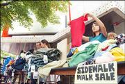 Esther Lim, Lawrence, right, rummages through some clothes during the annual Downtown Lawrence Sidewalk Sale. The event was from sunup to sundown on July 15.