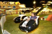 Kelly Gonzalis and his son Colin, 5, of Lawrence, ride the Spider. They attended the carnival Tuesday night at the Douglas County Free Fair. The carnival was provided by Tulsa, Okla.-based Murphy Brothers Exposition. About 35 workers helped operate 15 rides and 20 games during the past week.