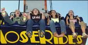 From left, 13-year-olds Sara Fevurly, Sarah Stern, Maddy Orth and Megan Andrews ride Freefall. They enjoyed the carnival rides Tuesday evening at the Douglas County Free Fair. The rides were operated by Tulsa, Okla.-based Murphy Brothers Exposition.