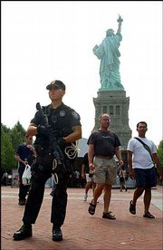 Sean Yun, a U.S. SWAT Team Park Police officer, stands guard outside the Statue of Liberty on New York's Liberty Island. Tuesday was the first day since Sept. 11, 2001, that tourists were allowed inside the statue.