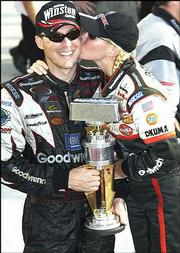 Devin Harvick, left, celebrates his win at the Brickyard 400 with his wife, Delana. Harvick won the race Aug. 3, 2003, in Indianapolis.