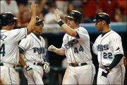 Tampa Bay's Toby Hall (44) accepts congratulations from teammates, from left, Tino Martinez, Julio Lugo and Jose Cruz Jr., after hitting a grand slam. Hall's seventh-inning blast lifted the Devil Rays past Boston, 5-4, Wednesday night in St. Petersburg, Fla.