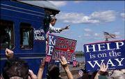 "Democratic presidential nominee Sen. John Kerry, D-Mass., arrives in Washington, Mo., on his campaign train during the ""Believe in America"" tour. Kerry said Thursday he would&squot;ve responded faster than President Bush did on Sept. 11. The train will pass through Lawrence today."