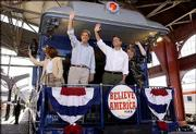Democratic presidential nominee Sen. John Kerry, D-Mass., and his running mate, Sen. John Edwards, D-N.C., wave to the crowd in St. Louis on their whistle-stop tour. With them are their wives, Teresa Heinz Kerry, left, and Elizabeth Edwards, right. The train came through Lawrence early today.
