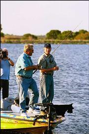 President Bush appears with with Roland Martin on Martin's fishing show for the Outdoor Life Network. The episode, taped at a lake on the president's Crawford, Texas ranch, aired Friday. Bush and Democratic presidential candidate John Kerry are accepting television appearances that give them opportunities to expand their image beyond politics.