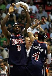 LeBron James, left, and Allen Iverson celebrate during their exhibition game against Turkey. The U.S. men's Olympic basketball team won, 79-67, Sunday at Abdi Ipekci Arena in Istanbul, Turkey.