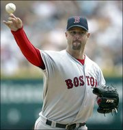 Boston knuckleballer Tim Wakefield fires a pitch against Detroit. Wakefield tied a modern major-league record by allowing six home runs, but he got the win as the Red Sox beat the Tigers, 11-9, Sunday in Detroit.