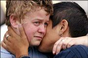 Lisa Weightman, 24, left, hugs her partner of five years, Shanna Orona, 31, both of San Francisco. The couple learned Thursday that the California Supreme Court had nullified the nearly 4,000 same-sex marriages sanctioned in San Francisco this year.