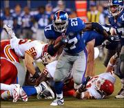 New York running back Ron Dayne breaks through the line for a 29-yard touchdown against Kansas City. Dayne finished with 11 carries for 118 yards and two scores in the Giants' 34-24 victory Friday night at Giants Stadium in East Rutherford, N.J.