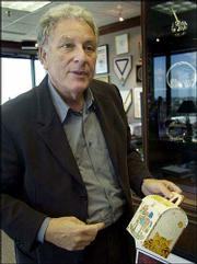 Bob Bernstein holds an original Happy Meal box at his Bernstein-Rein Advertising Inc. office in Kansas City, Mo. Bernstein, who was pictured Thursday, is the inventor of the Happy Meal, which is 25 years old.