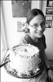 Hollie Rice, a Kansas University graduate student, shows her ceramic cakes at Olive Gallery & Art Supply, 15 E. Eighth St. The Olive is one of several student-friendly galleries in Lawrence.
