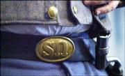 """Denver Erickson, Topeka, wears a Civil War replica belt buckle turned upside down to """"SN"""" for South Nation instead of """"US"""" for United States. Erickson, a member of Sons of Confederate Veterans, lectured Saturday afternoon at the Watkins Community Museum of History, 1047 Mass., as part of the """"Civil War on the Western Frontier"""" program."""