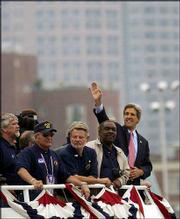 Kerry, at right, is joined by fellow Vietnam veterans and crewmates in a water taxi on the Boston harbor during the Democratic National Convention in July. Military documentation that has been made public generally supports the view put forth by Kerry and most of his crewmates -- that he acted courageously and came by his Silver Star, Bronze Star and three Purple Hearts honestly.