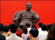 Visitors look at the bronze statue of Deng Xiaoping, which was installed to celebrate the 100th anniversary of his birth, in Guangan, Deng's hometown in southwest China. Deng led China from 1978 to 1989.
