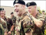 Army Reserve Sgt. Jared Myers, center, is congratulated by members of the 418th Battalion after being awarded the Bronze Star for his bravery in Iraq. Myers, 24, of Lawrence, received the medal for actions after an attack on his convoy that left one passenger in his Humvee dead and another critically wounded. The Sunday afternoon recognition ceremony was at the former Richards Gebaur Air Force Base in Belton, Mo.