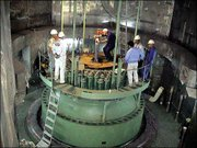 Technicians measure part of the reactor of Iran's Bushehr nuclear power plant, southwest of the capital Tehran, Iran, in this undated photo released by Iran's Atomic Energy Organization. Iran said Sunday it planned to build more nuclear power plants with Russia's help, ignoring U.S. concerns that byproducts from the plants could be used to manufacture atomic bombs.