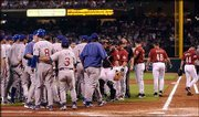 The Cubs and Astros posture after Houston pitcher Roy Oswalt (44) hit Chicago's Michael Barrett (8) with a pitch in the third inning. Oswalt was ejected from the game Sunday in Houston.