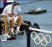 American Mardy Fish reacts after losing the men's gold-medal singles match against Nicolas Massu of Chile. Massu won, 6-3, 3-6, 2-6, 6-3, 6-4, Sunday in Athens, Greece.